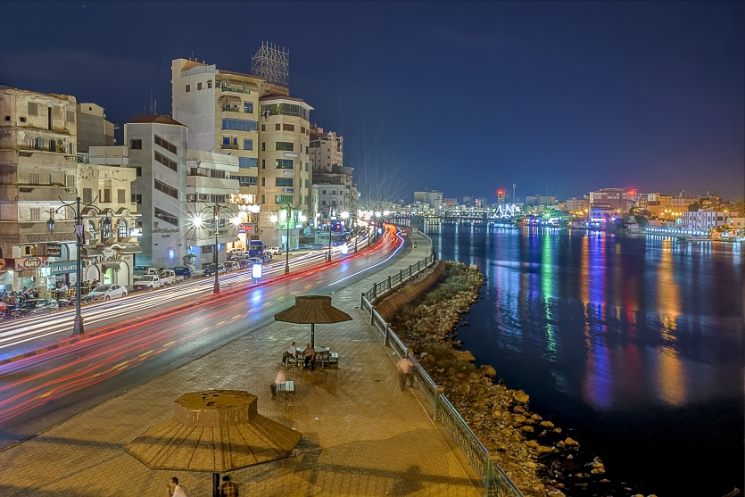 Streets of city by Nile at night +++