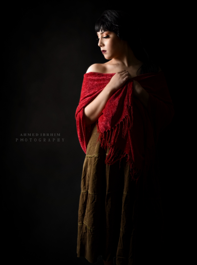 A woman in a red shawl