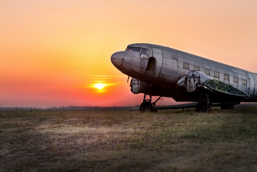 An old airplane and beautiful sunset