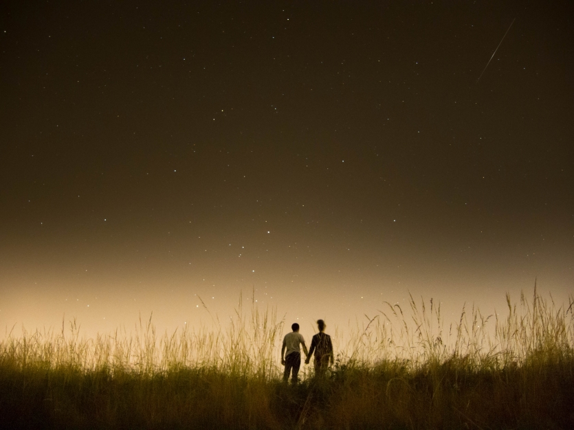 Lovely couple watching the sky