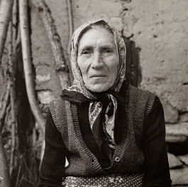 Old woman with golden hands