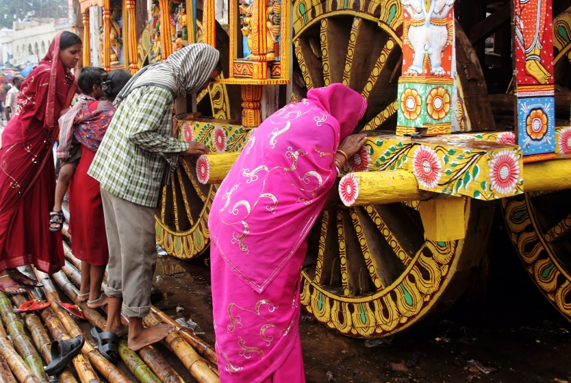 Worshipping Lord Jagannath's wooden Chariot
