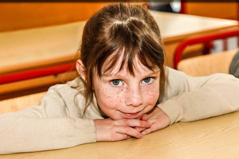 primary school student schoolgirl gray eyes  baby  holiday blue