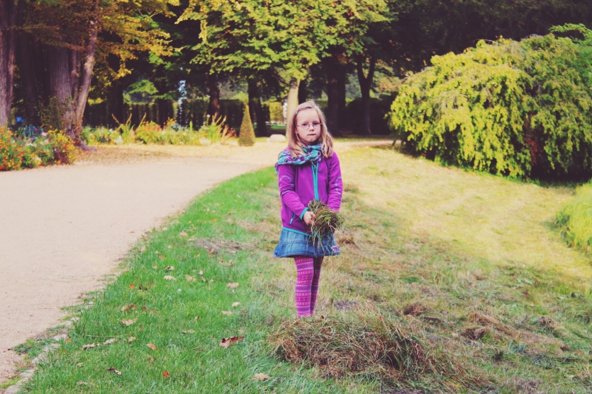 Girl and dry grass