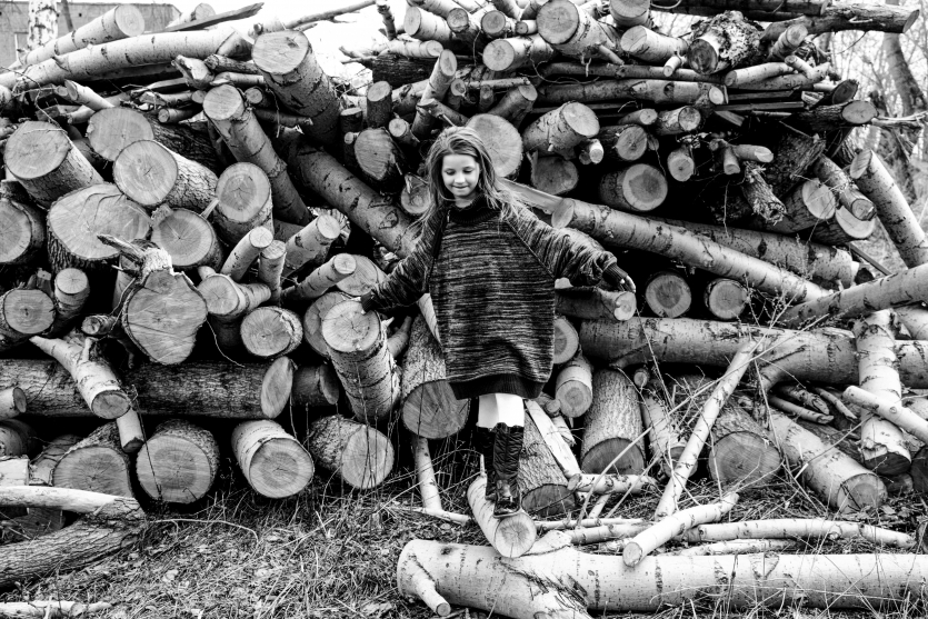 The child goes on logs of trees, Russia