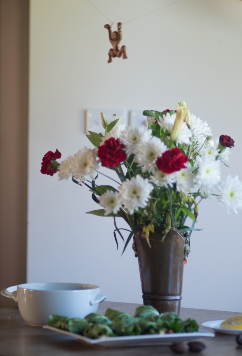 A vase with a flowers on a dining table