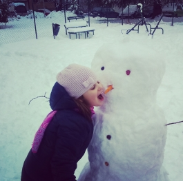 Eating a snowman's nose