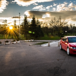 Mitsubishi Lancer Evolution VIII with sunset