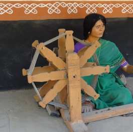 an Indian Woman with Spinning Wheel (Charkha)