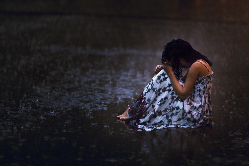 Loneliness under the patter of rain