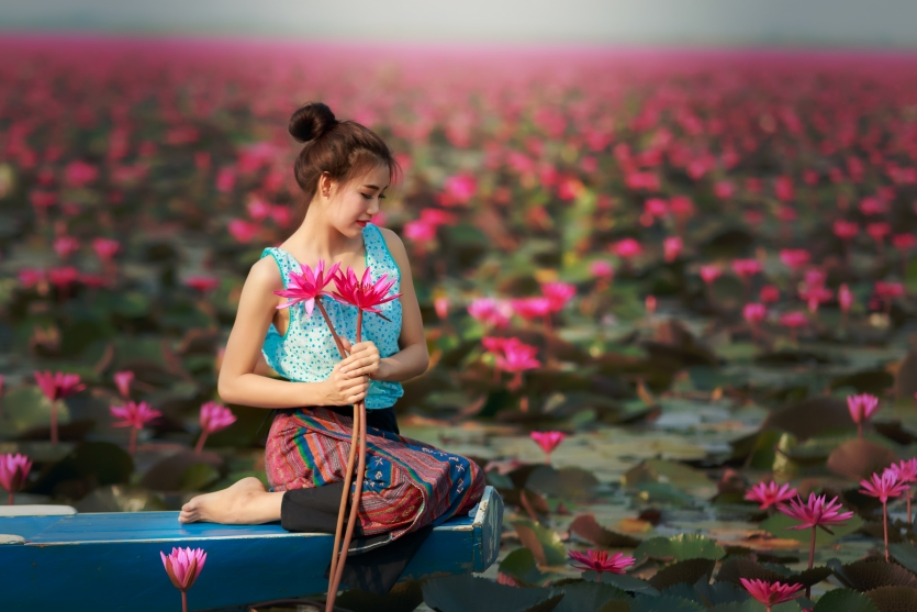 Portrait of a beautiful women in lotus garden.