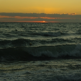 Sunrise on a beautiful morning at the seaside over the waves