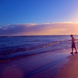Father, son and sunset in the beach...