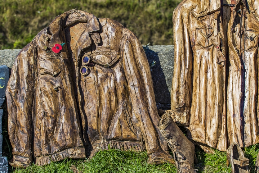 Carved wooden coats