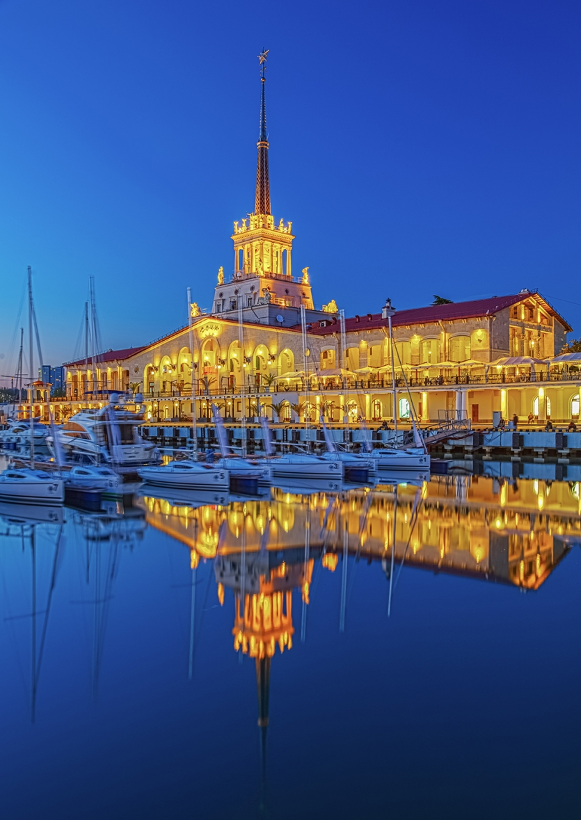 Gold reflection of seaport. City of Sochi