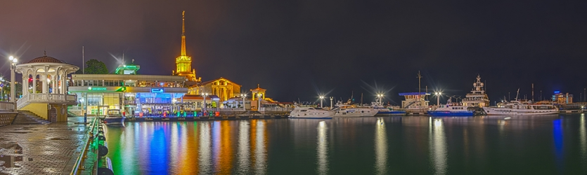 Night panorama of the shallow mooring of seaport Sochi city
