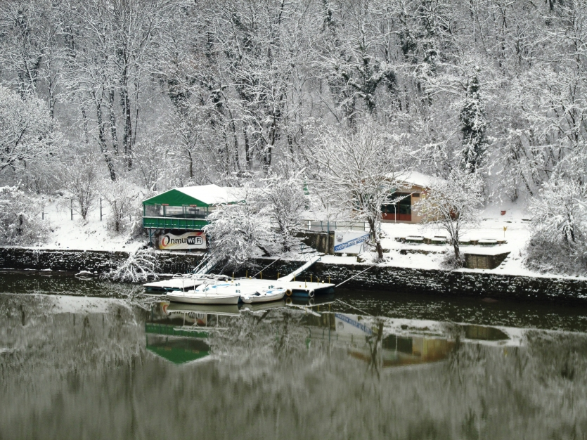 Boats in the winter lake