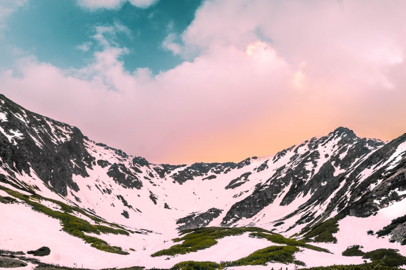 Snowy mountain ridge at sunset