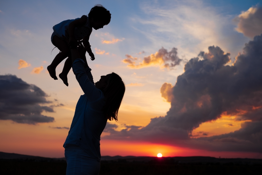 mother raised daughter in a sunset
