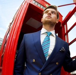 A businessman in London in blue double-breasted suit
