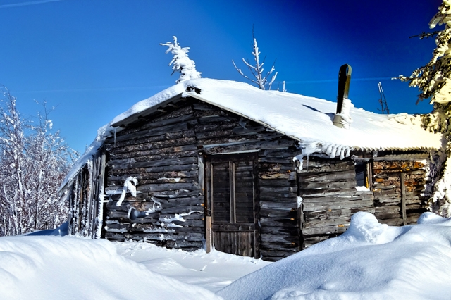 Hunting lodge in snowy mountain