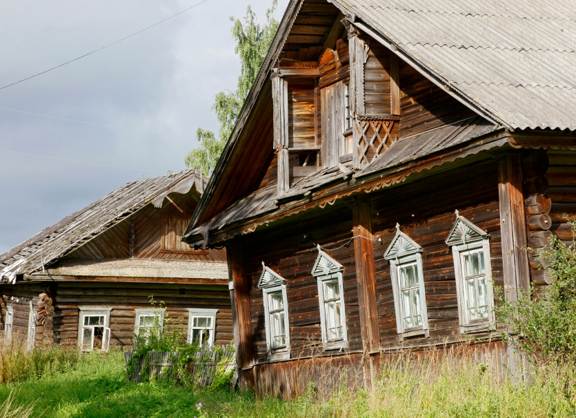 Abandoned wooden houses in the village of Mal`gino, Russia