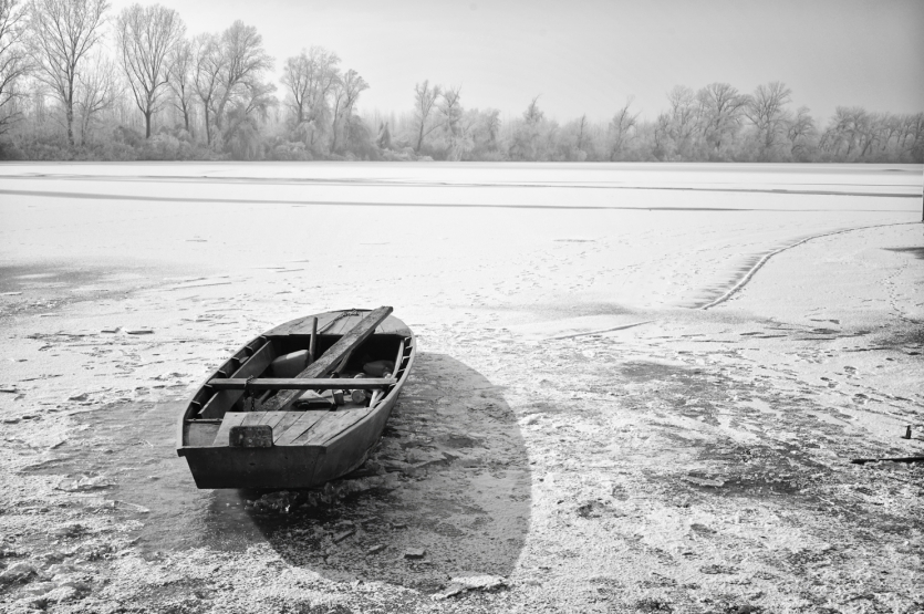 The boat on the frozen river