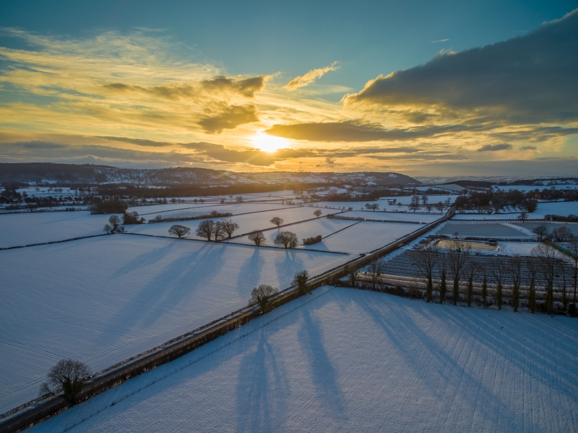 Sunset over cold fields