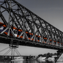 Red train and grey bridge