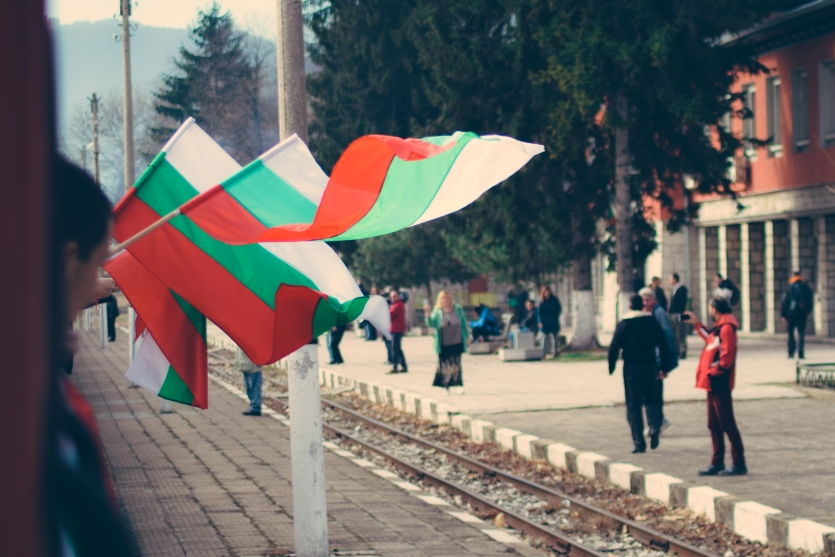 National bulgarian flags at the Velingrad train station, Bulgaria.