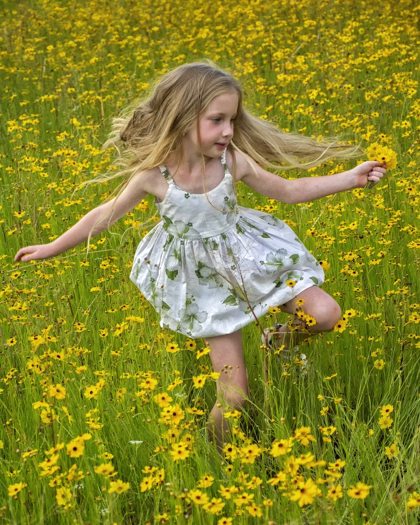 Gianna running through the wildflowers