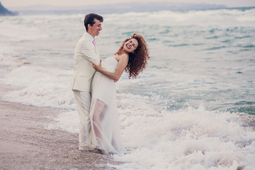 Trying to be romantic when the waves of the Sea are coming at us! :D