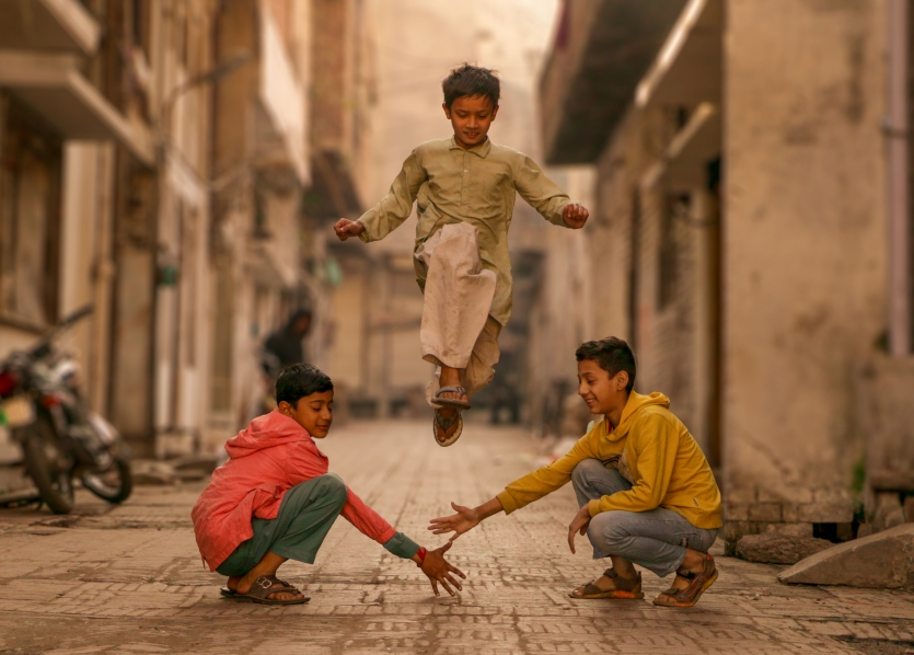 Children playing their traditional childhood games