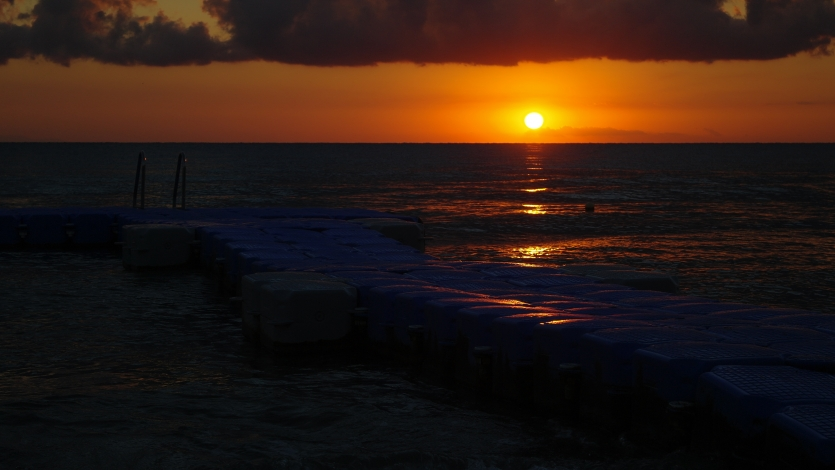 A beautiful orange and yellow sunrise over the sea