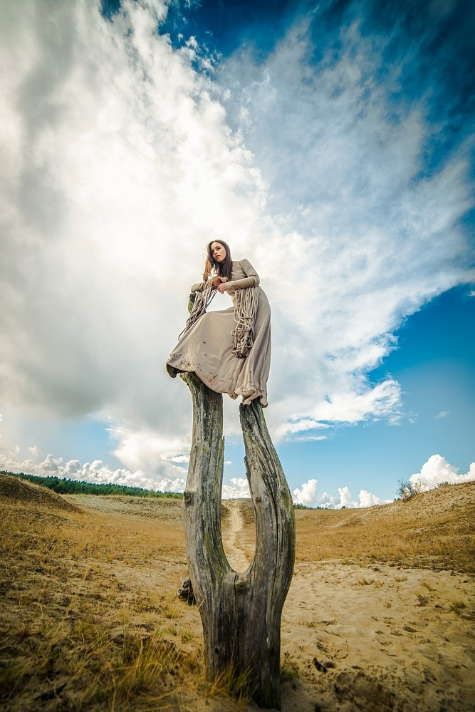 Girl on the dead tree