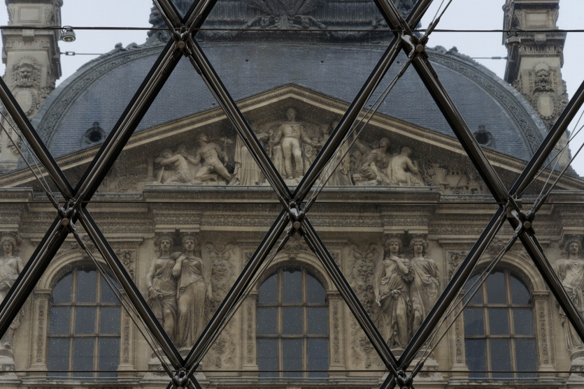 A view of the Louvre through the glass pyramid