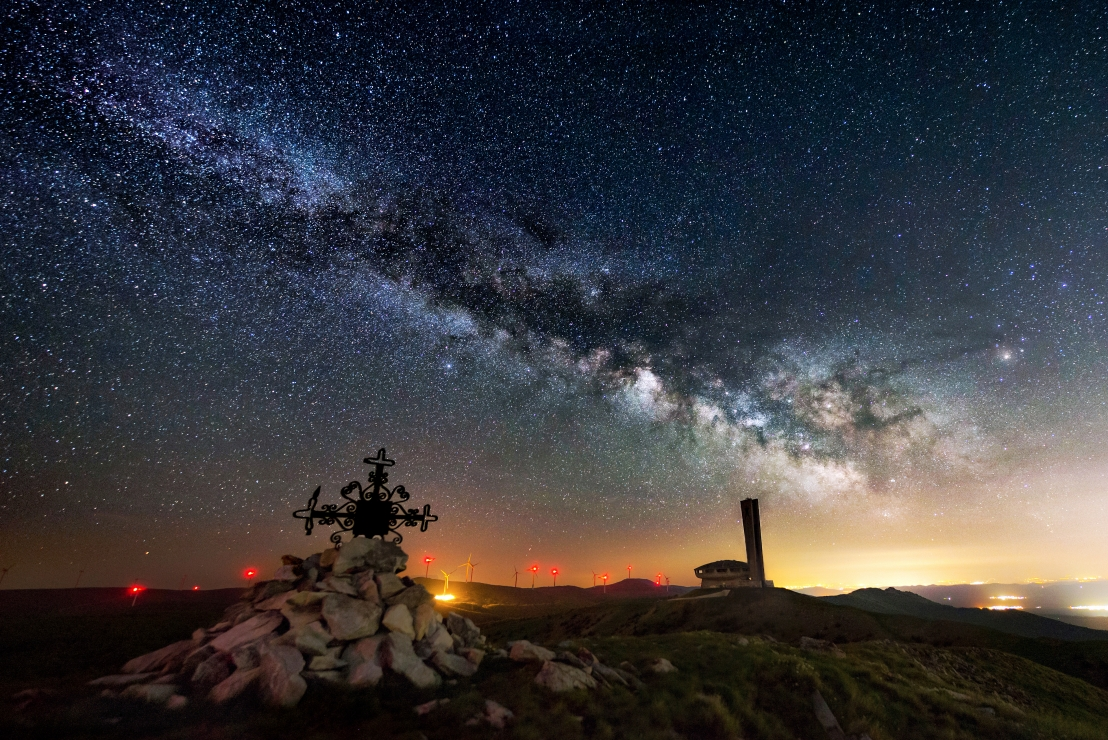 Milky way over abandoned monument of Buzludzha peak