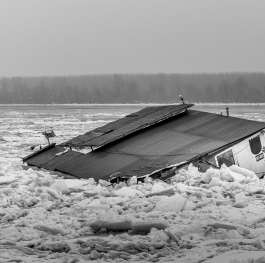 Old abandoned house sank into frozen Danube