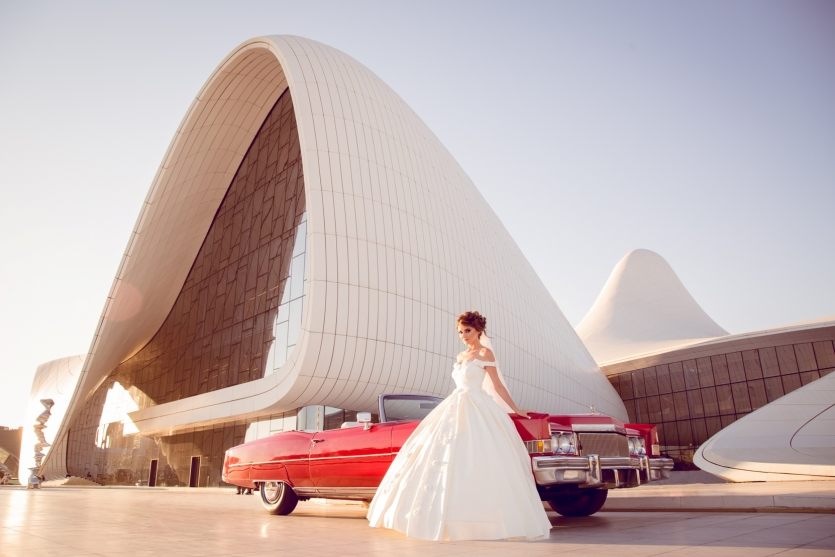 wedding dress and red car