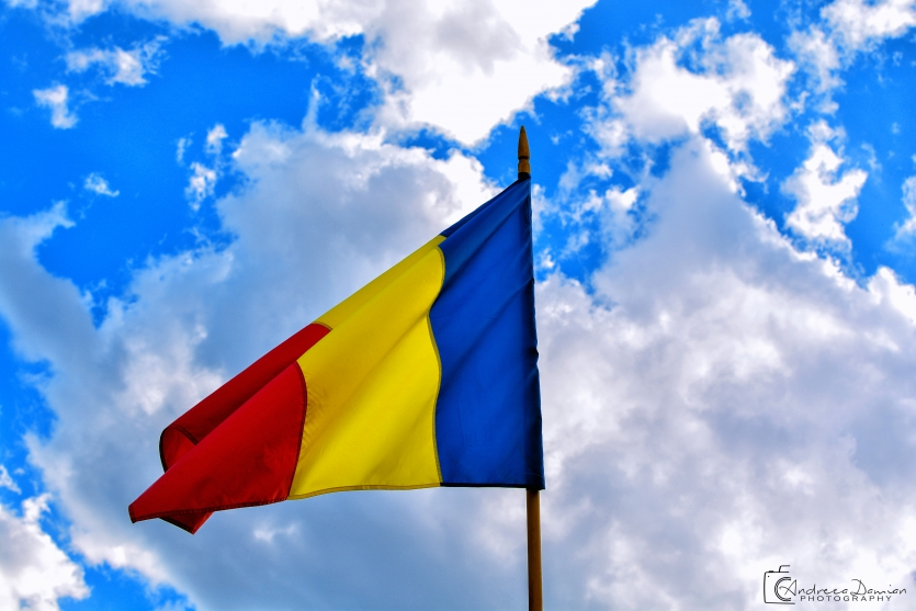 Romanian waving flag high in the sky