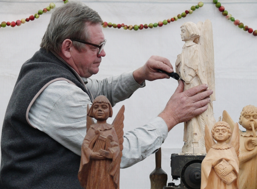 Local wood artist carving angels out of wood