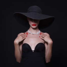 Diamond necklace and black hat.