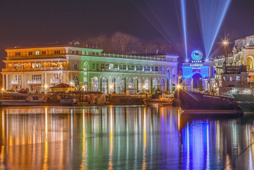 Night reflection in seaport Sochi of the city