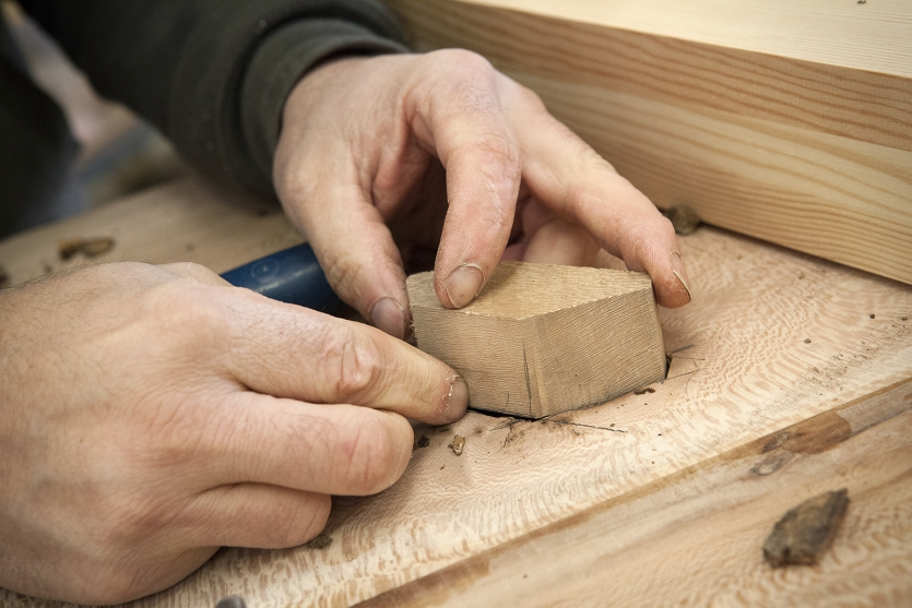 Hands and wood, a story of work as old as time